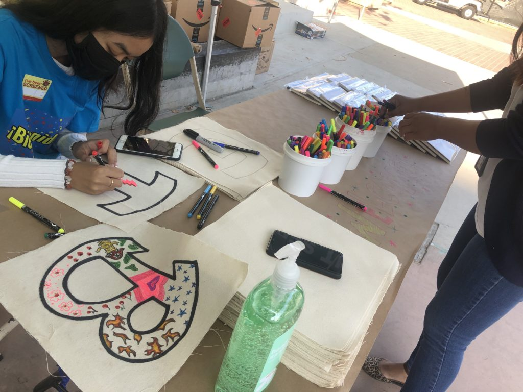 Youth participating in arts and crafts during the Office of Immigrant Affairs' Welcome Day